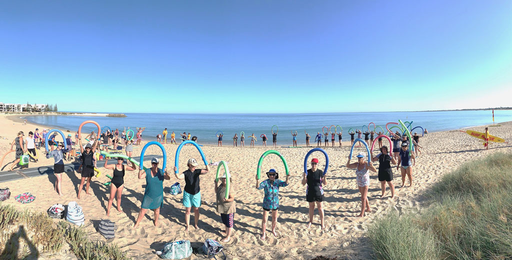 SRCWA Peel Branch Double Dip Program attendees warming up session before entering the ocean at Town Beach Mandurah.