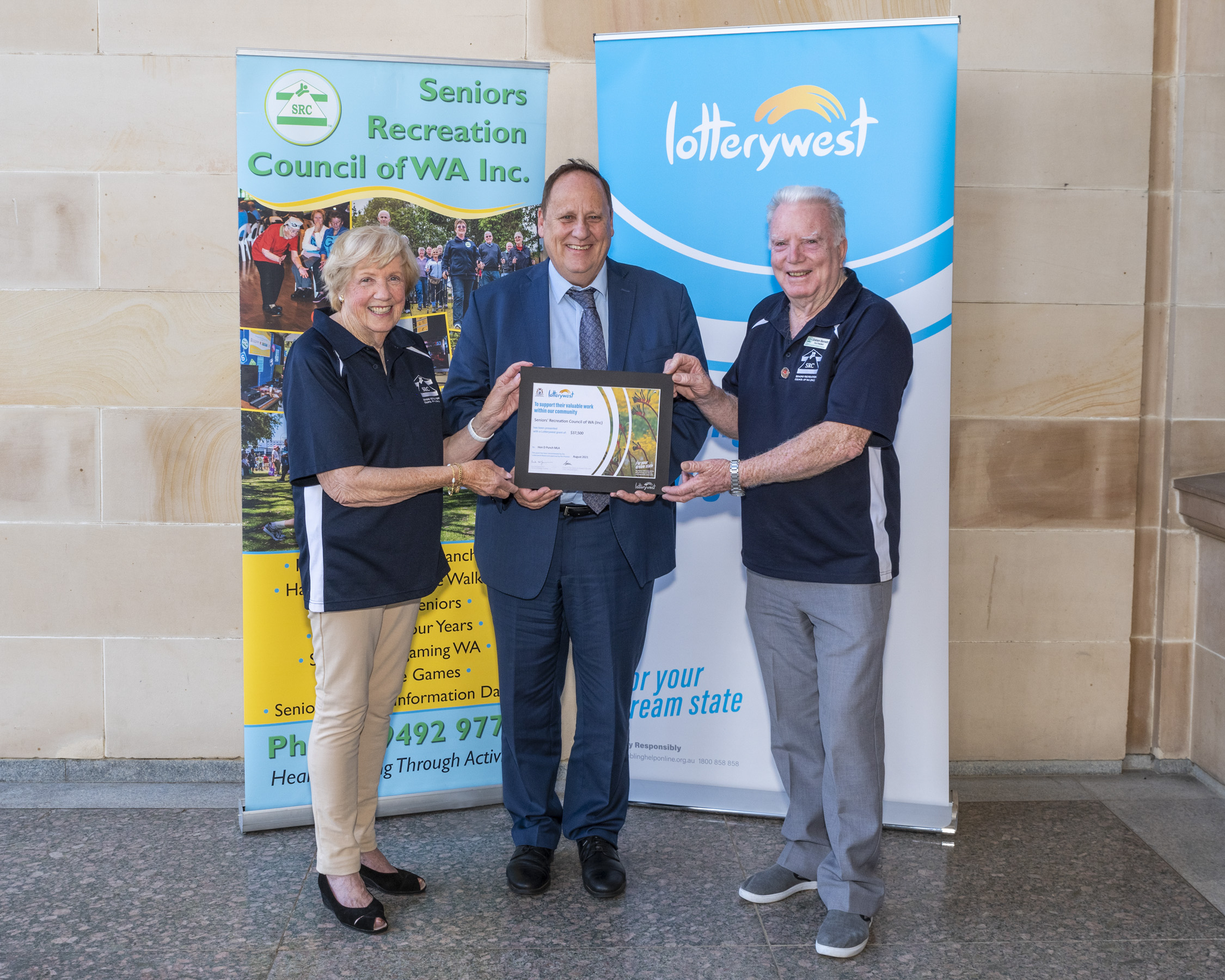 Hon. Don Punch MLA , Minister for Seniors and Ageing; presents a Lotterywest Cheque to SRCWA